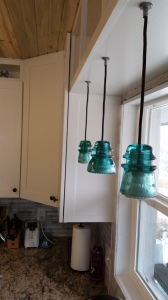 These lights hang above the sink. El Guapo made them from electrical insulators. He's even sold some on craigslist! They are really a great addition to the kitchen-and the light they bring is great, too!
